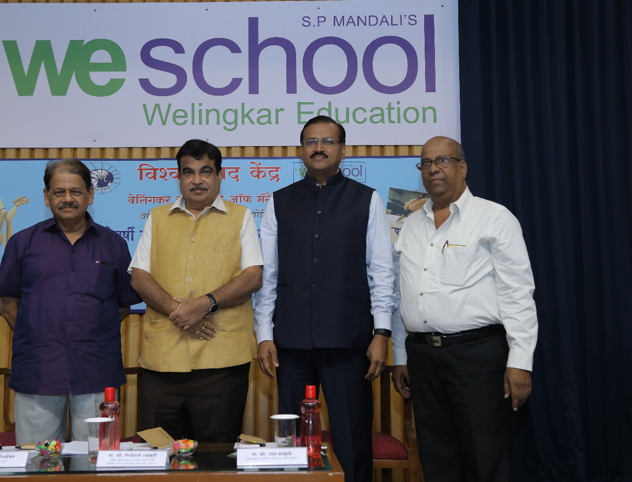 Honouring journalists at an award ceremony,  WeSchool